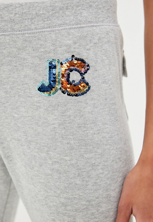 Фото 4 - Брюки спортивные Juicy Couture серого цвета
