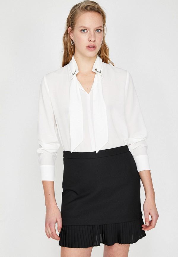Фото - Женскую блузку Koton белого цвета