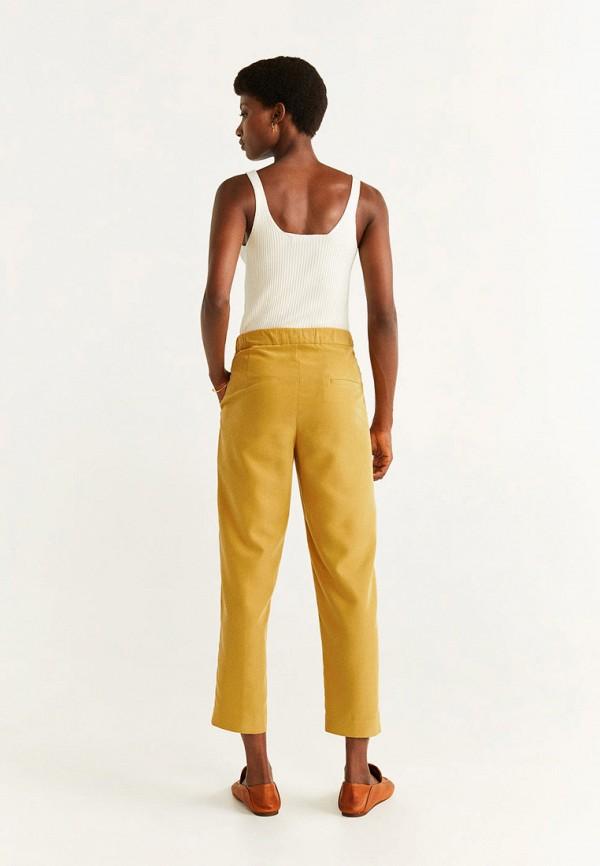 Фото 3 - женские брюки Mango желтого цвета