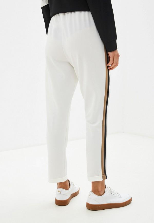 Фото 3 - женские брюки Massimiliano Bini белого цвета
