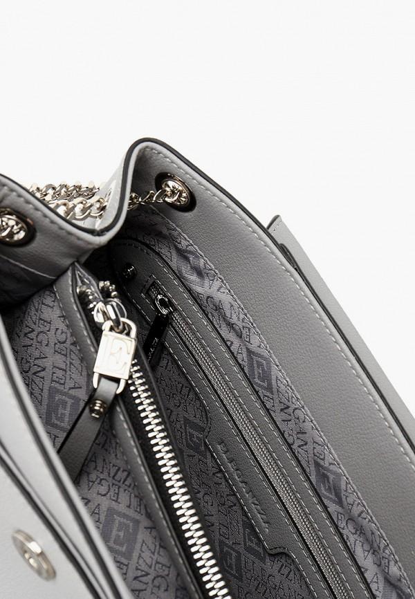 Фото 3 - Женскую сумку Eleganzza серого цвета