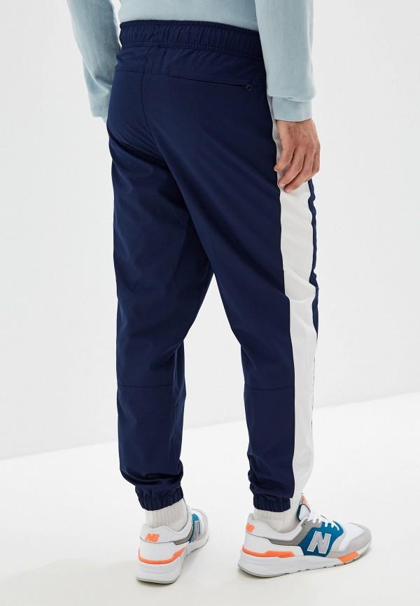 Фото 3 - Брюки спортивные New Balance синего цвета