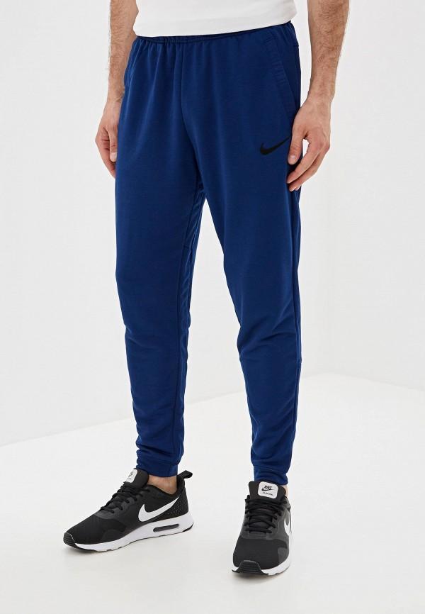 Фото - Брюки спортивные Nike синего цвета