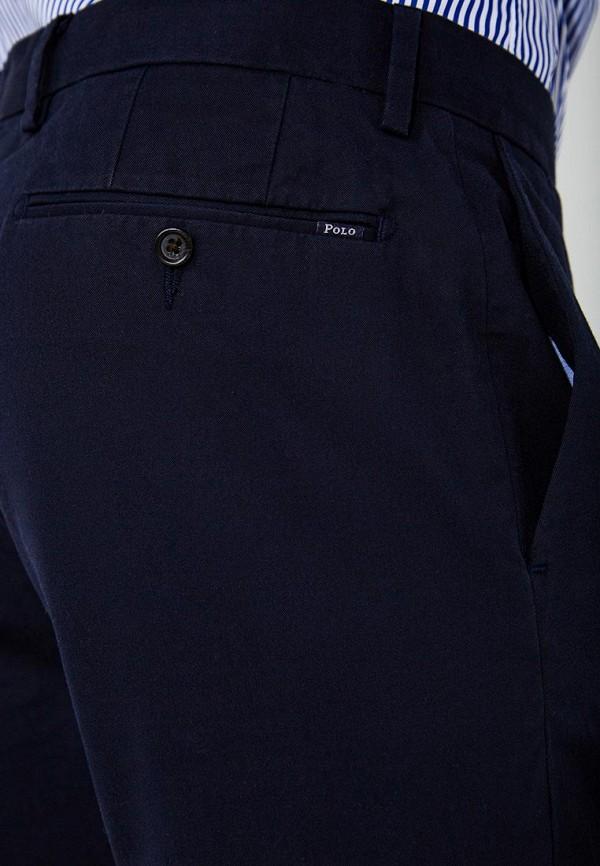 Фото 4 - мужские брюки Polo Ralph Lauren синего цвета