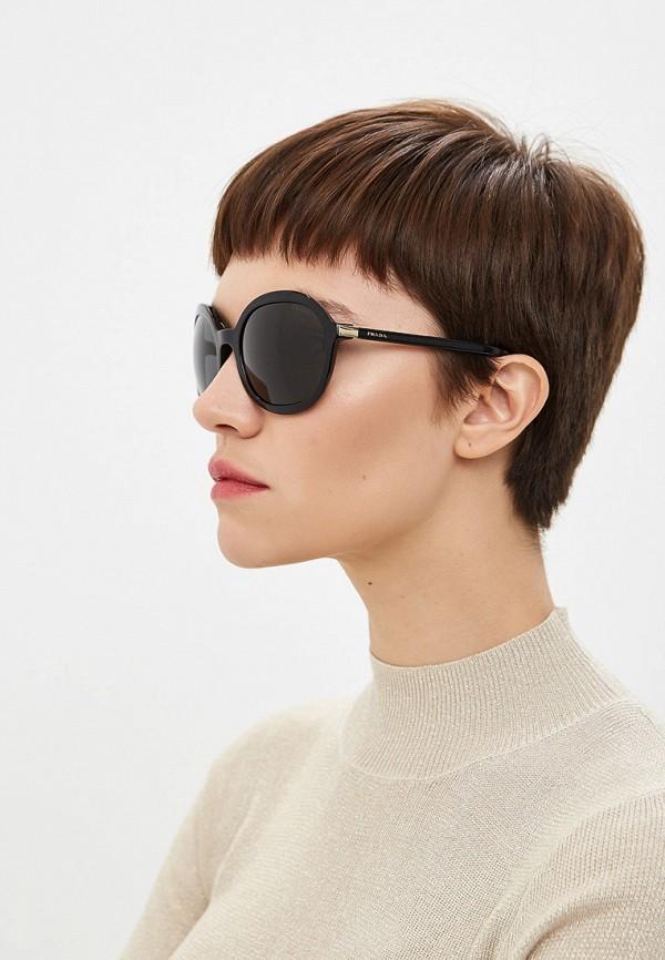 Фото 6 - Очки солнцезащитные Prada черного цвета