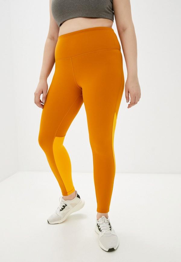 Леггинсы Reebok оранжевого цвета