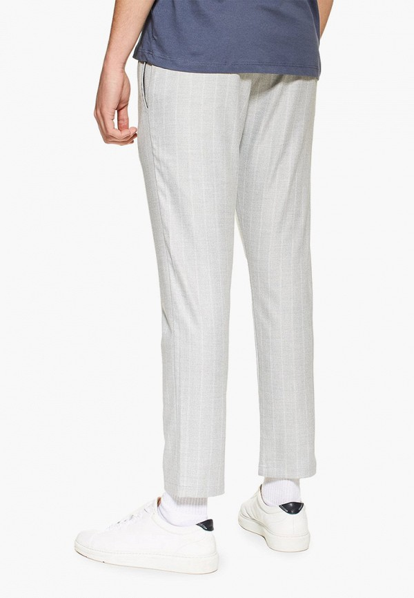 Фото 3 - мужские брюки Topman белого цвета