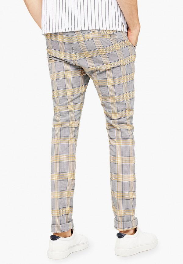 Фото 3 - мужские брюки Topman бежевого цвета