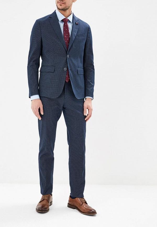 Фото 2 - мужские брюки Tommy Hilfiger синего цвета